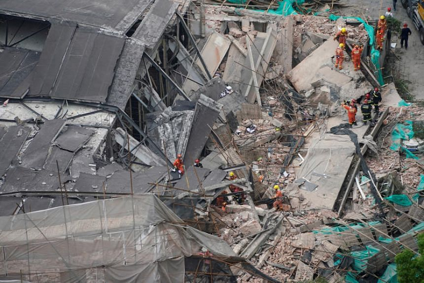 Emergency rescue personnel at the site of the building collapse in Shanghai on May 16, 2019.