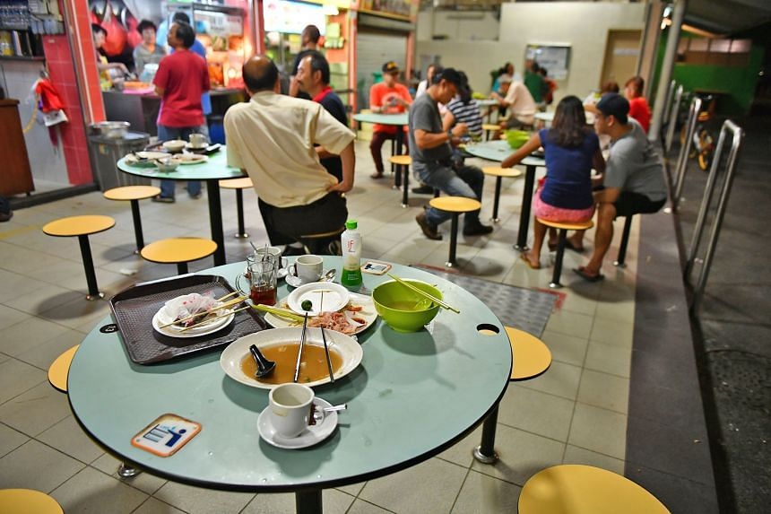 Discarded food and drinks at Orchard MRT station and a Toa Payoh hawker centre (above). In the Public Cleanliness Satisfaction Survey last year, respondents said trash was seen more in hawker centres than in places like wet markets and on public pave