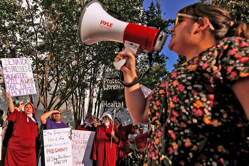 Pro-choice supporters protesting in front of the Alabama State House in Montgomery, Alabama, on Tuesday as the state Senate voted on the strictest anti-abortion Bill in the United States.