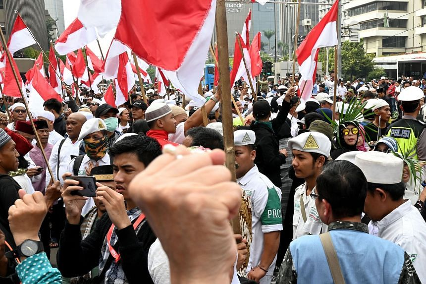 Mr Prabowo Subianto's supporters protesting last Friday against alleged vote-rigging. Mr Prabowo has rejected interim results which indicate that President Joko Widodo has won by a comfortable margin.