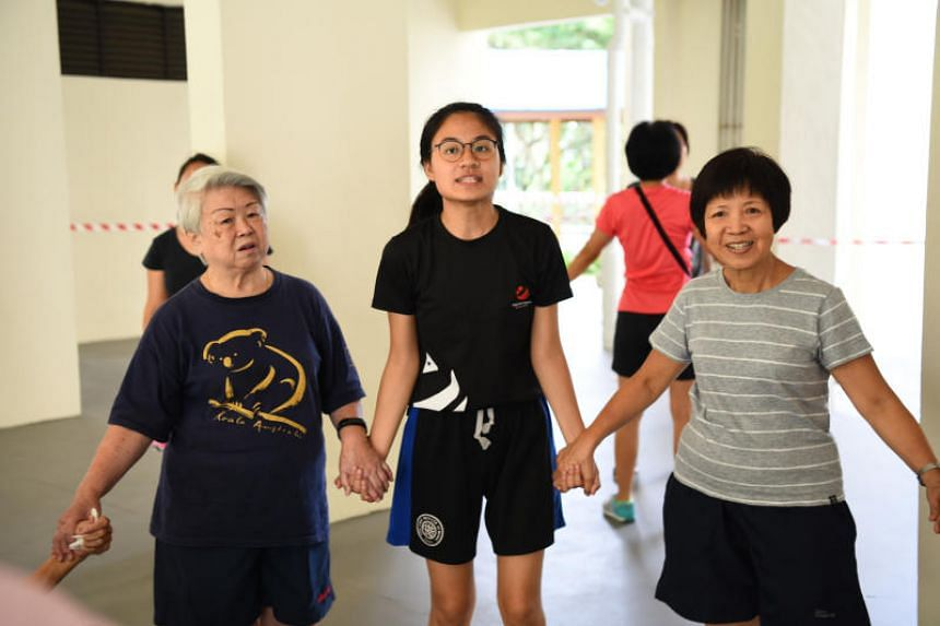 Dawn Lim (centre), spends four to 10 hours a week volunteering as a Youth Corps Singapore ambassador.