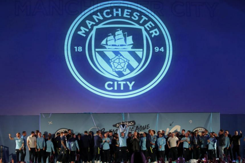Manchester City players celebrating after winning the Premier League at the Etihad Stadium, on May 12, 2019.