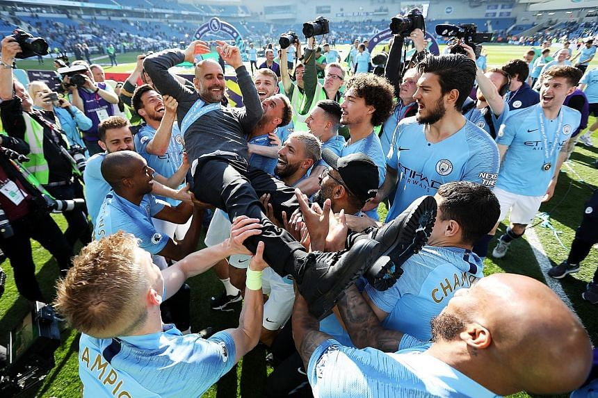 Manchester City manager Pep Guardiola being lifted by his players after retaining the Premier League title last Sunday. The club are facing a final judgment over allegations of misleading Uefa over Financial Fair Play. If found guilty, City could fac