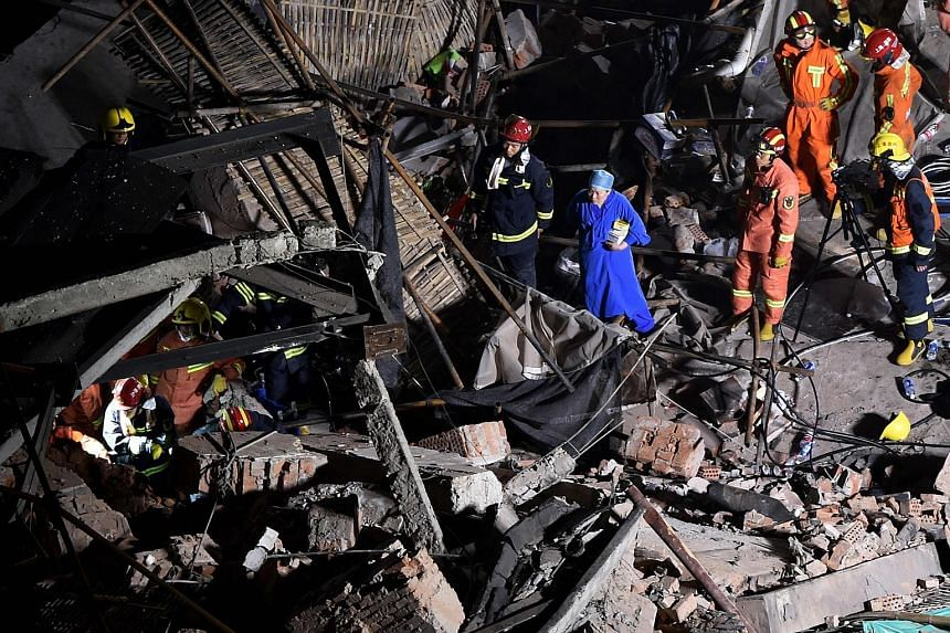 Rescuers trying to find survivors amid the rubble of the collapsed building in Shanghai yesterday. PHOTO: AGENCE FRANCE-PRESSE