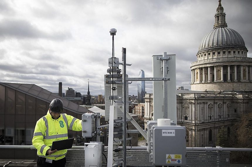 An engineer from British wireless network provider EE checking 5G masts and Huawei 5G equipment during trials in London earlier this year. Huawei has been the leading vendor in supplying 5G network equipment, having secured 40 global contracts.