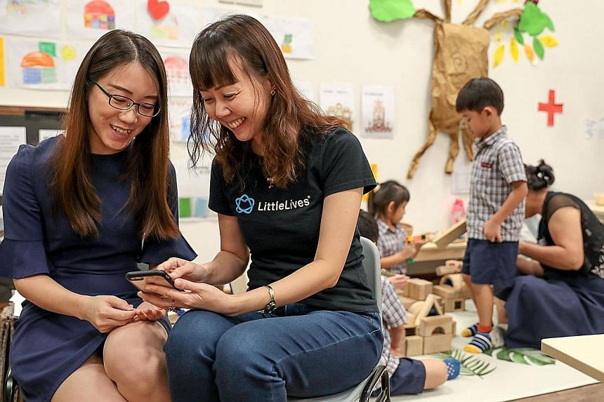 LittleLives app founder Sun Ho (right) with principal of E-Bridge Pre-School (Bukit Panjang), Ms Chua Chai Yun. LittleLives, a pre-school management app, has launched a payment feature that will save pre-school operators up to 40 hours a month on pay