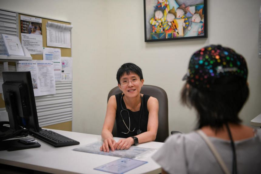 Associate Professor Lee Soo Chin, head of the department of haematology-oncology at the National University Cancer Institute, Singapore, with breast cancer patient Kwok Pui Yee.