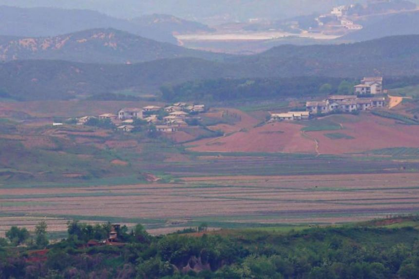 North Korea's border county of Kaepoong, seen from a South Korean observation post in Paju near the Demilitarised Zone dividing the two Koreas on May 17, 2019.