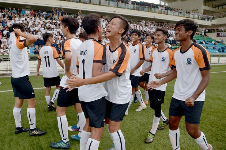 St Andrew's Junior College players celebrate after their 4-1 win against Victoria Junior College in the Schools National A Division boys' football final.