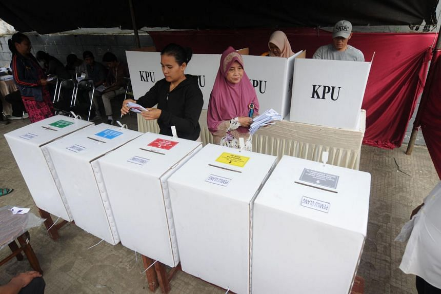 Indonesian voters cast their ballots during a revote due to discrepancies in Tangerang, on April 24, 2019.
