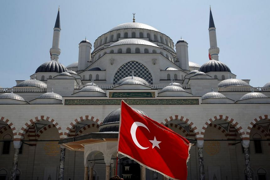 A Turkish flag at the courtyard of the Grand Camlica Mosque in Istanbul, Turkey, on May 3, 2019.