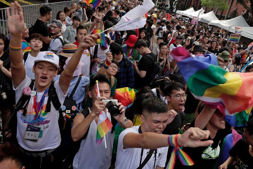 Supporters of same-sex marriage celebrate as they gather outside the parliament building as a bill for marriage equality is debated by parliamentarians in Taipei, Taiwan, on May 17, 2019.