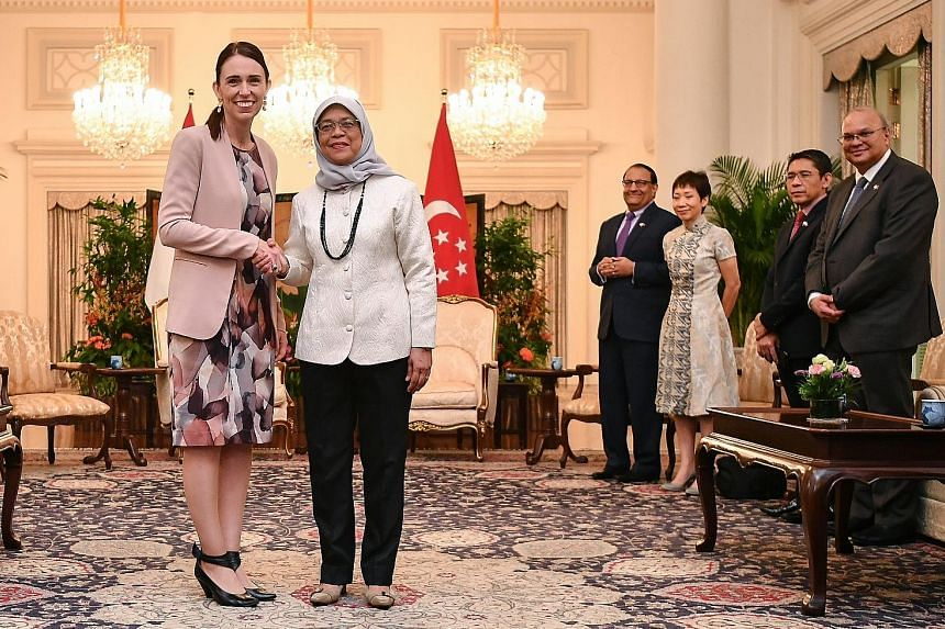 Ms Ardern meeting President Halimah Yacob at the Istana yesterday. With them are (from right) Singapore High Commissioner to New Zealand Bernard Baker; Senior Minister of State for Defence and Foreign Affairs Maliki Osman; Minister for Culture, Commu