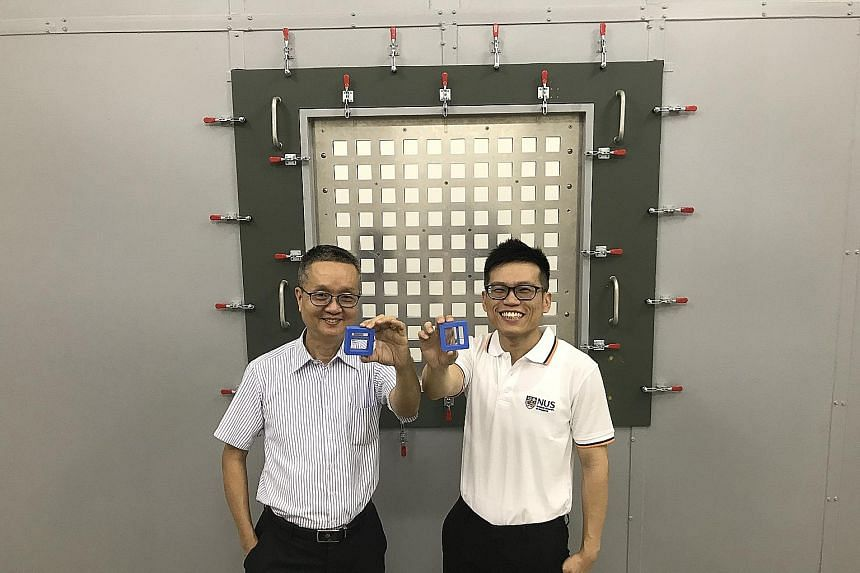 Associate Professor Lee Heow Pueh (left) and doctoral student Ang Yinn Leng Linus with their 3D-printed noise reduction block designed to target low-frequency sounds of 500Hz and lower.