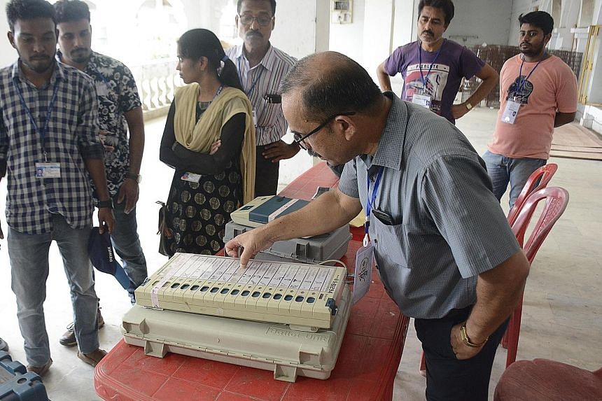 An official inspecting an electronic voting machine before it was moved to a polling station in Agartala, the capital of the north-eastern state of Tripura, last Saturday. Such machines have been in use in India since 2004. PHOTO: AGENCE FRANCE-PRESS