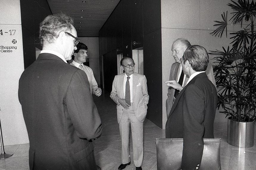 Above: Mr Pei (centre) visiting Raffles City in Singapore in October 1986. Right: The Gateway in Beach Road. The glass pyramid project for the Louvre Museum in Paris was deeply controversial, and Mr I.M. Pei endured a roasting from critics. But his c
