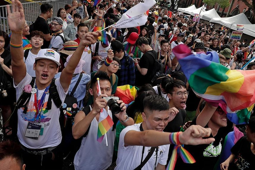 "Supporters of same-sex marriage gathering outside the Parliament building in Taipei yesterday as a Bill for marriage equality was debated by parliamentarians. Lawmakers comfortably passed the Bill allowing same-sex couples to form ""exclusive permanen"