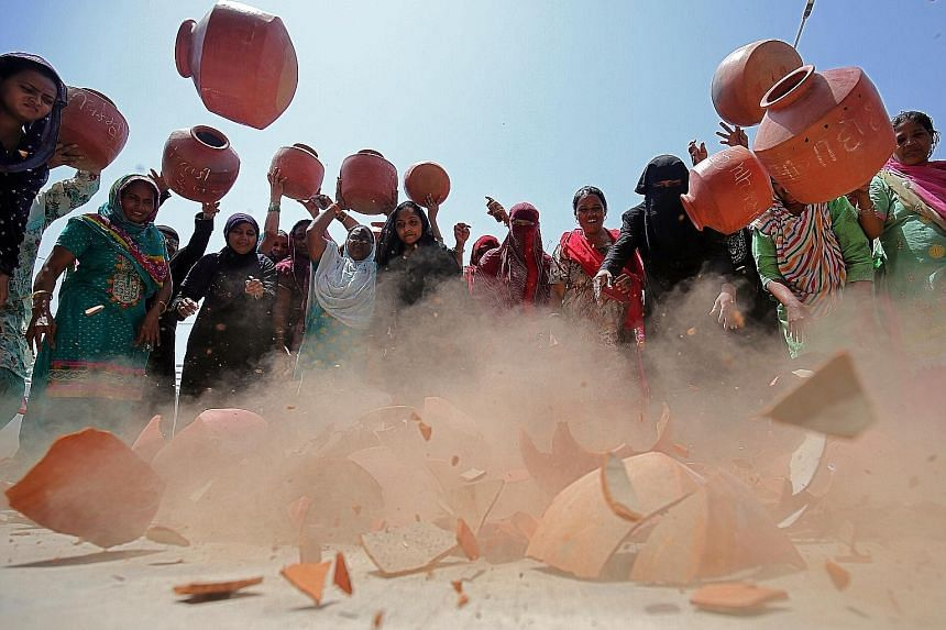 Women throwing earthen pitchers onto the ground on Thursday in protest against a shortage of drinking water outside the municipal corporation office in Ahmedabad, India. From South Africa to India, and across North Africa and the Middle East, water s