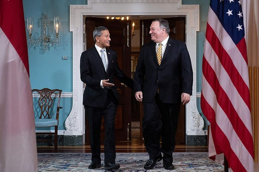 Foreign Minister Vivian Balakrishnan arriving alongside US Secretary of State Mike Pompeo prior to meetings at the State Department in Washington on Thursday. Dr Balakrishnan said Singapore's ties with the US are excellent and their defence relations