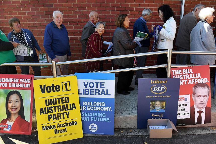 Pre-poll voters waiting to cast their ballots in the seat of Chisholm in Melbourne. Despite Australia enjoying 27 years of economic growth, voters appear inclined to switch to the Labor party following six tumultuous years in which the Coalition has