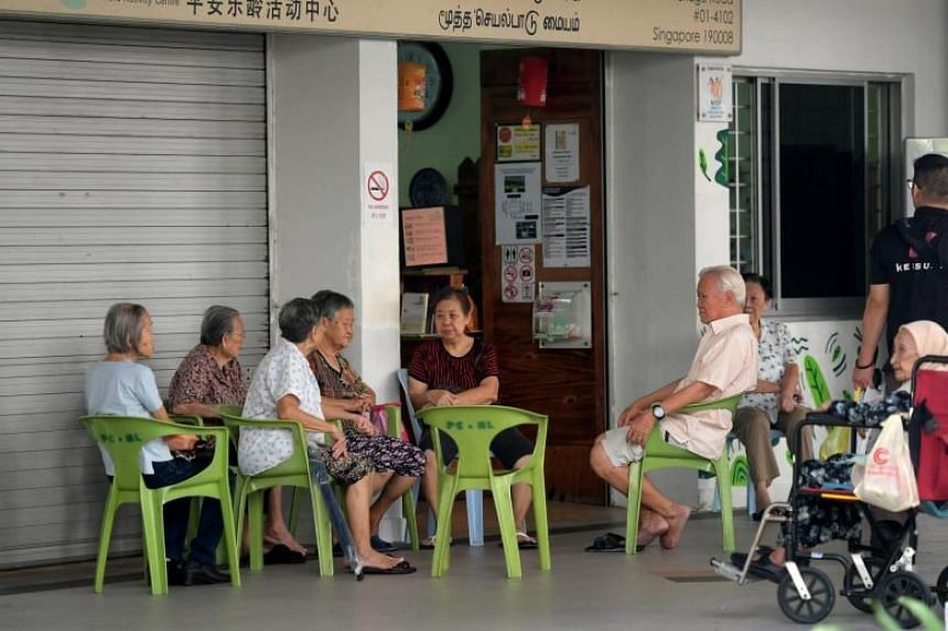 A group of elderly people in North Bridge Road.