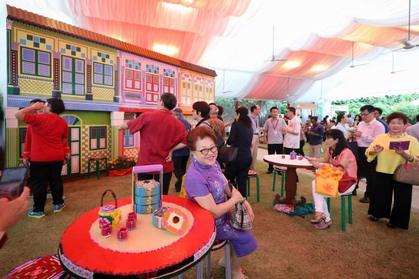 Guests pose for pictures at the Chinese New Year Garden Party at The Istana Lawn held to thank grassroots and community leaders for their dedication and contributions to the community on Feb 17, 2019.