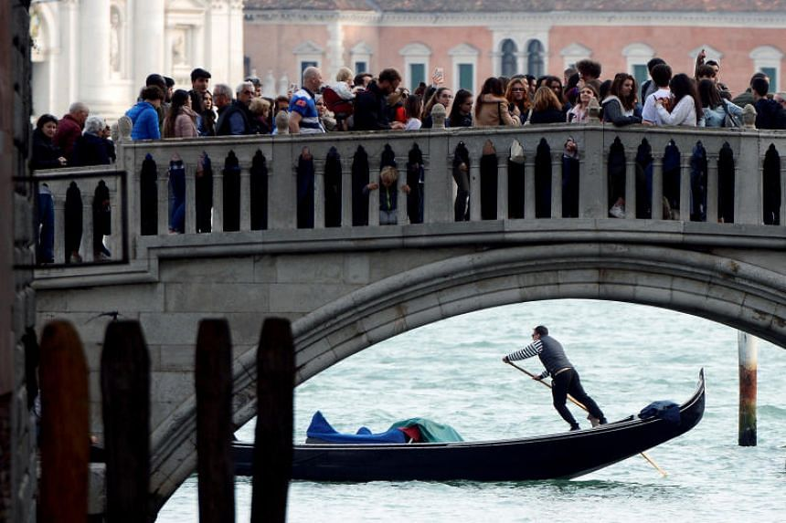 Venice hosts around 25 million tourists a year, of whom 14 million spend just one day there, crowding the alleys and the Renaissance churches around the canals.