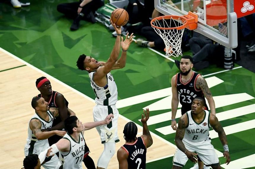 Giannis Antetokounmpo of the Milwaukee Bucks attempts a shot against the Toronto Raptors during Game 2 of the Eastern Conference Finals of the 2019 NBA Playoffs at the Fiserv Forum in Milwaukee, Wisconsin, on May 17, 2019.