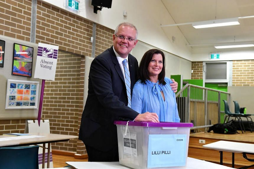 Australian Prime Minister Scott Morrison and his wife Jenny casting their votes at Lilli Pilli Public School in Sydney.