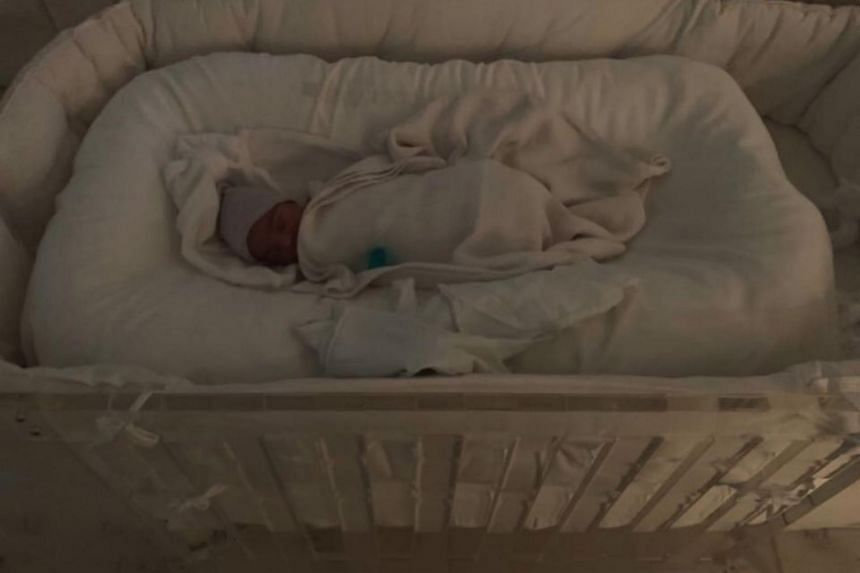 """Kardashian wrote """"Psalm West"""" in a post to her 60 million followers on Twitter that included a photo of the infant wrapped in a blanket in a crib."""