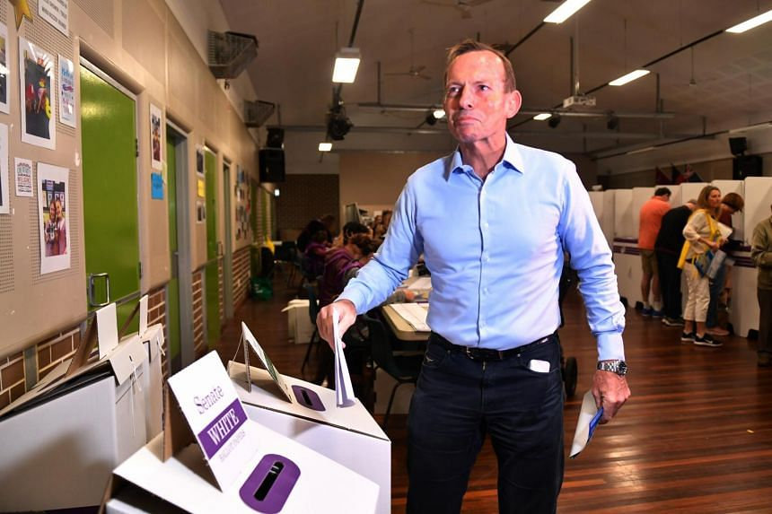 Former Australian prime minister Tony Abbott votes at Forestville Public School on Election Day in Sydney on May 18, 2019.