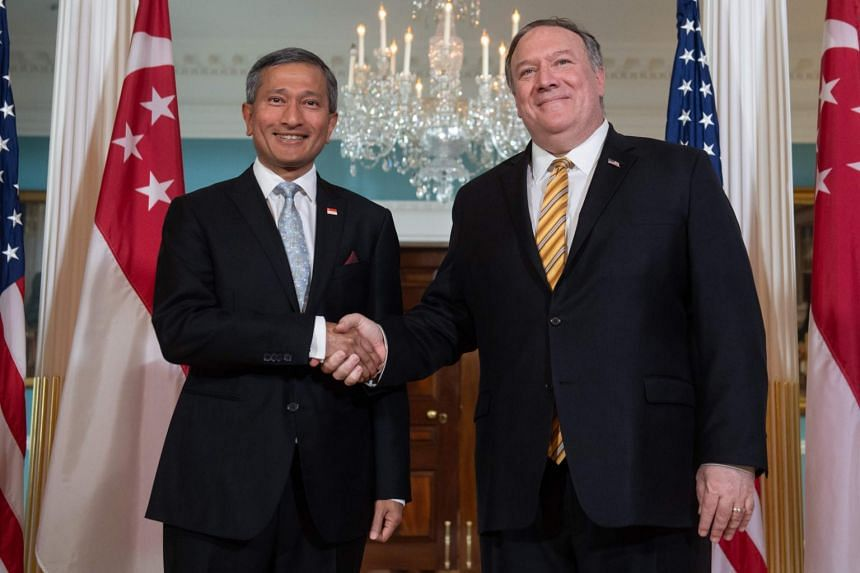 Singapore's Foreign Minister Vivian Balakrishnan (left) shakes hands with US Secretary of State Mike Pompeo prior to meetings at the State Department in Washington, on May 16, 2019.