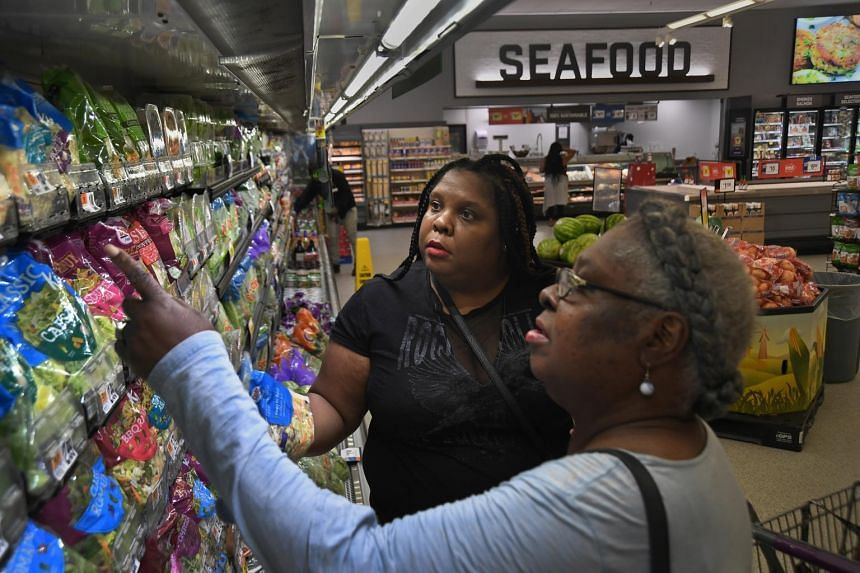 Ms Adrienne Dove (left) and her mother shop for produce at a Giant store in Washington.