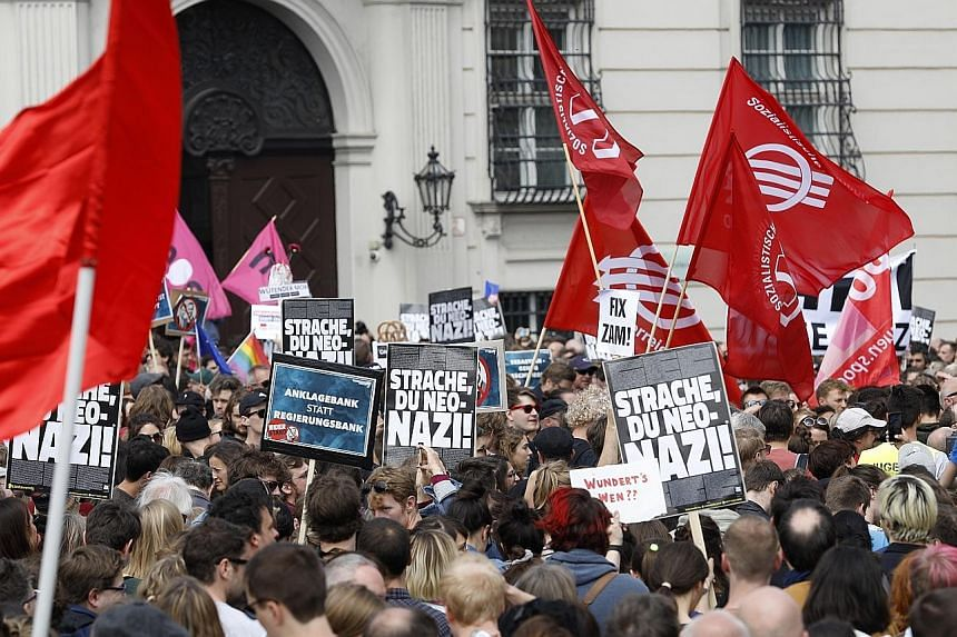 Protesters outside the Vienna office of Austria's Vice-Chancellor Heinz-Christian Strache (above), who is stepping down after being compromised in a sting operation. PHOTO: EPA-EFE