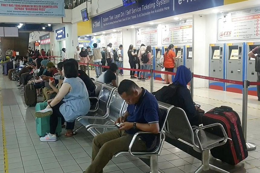 Commuters waiting inside the Larkin bus terminal. Malaysia's Iskandar Regional Development Authority is preparing to roll out a Bus Rapid Transit system to beat congestion and encourage more people to use public transport. ST PHOTO: ARLINA ARSHAD