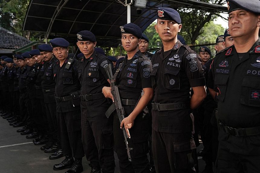 Members of the Indonesian National Police at the General Election Commission in Jakarta last week. Nearly 32,000 police and military personnel will be on standby in the Indonesian capital on Wednesday, ahead of the announcement of the election result