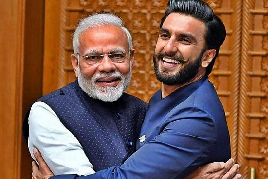 Left: Indian Prime Minister Narendra Modi, seen here with actor Ranveer Singh, has roped in Bollywood stars in his bid for a second term in office. Right: South Korean President Moon Jae-In stroking his pet dog, Tory, in his Seoul residence.