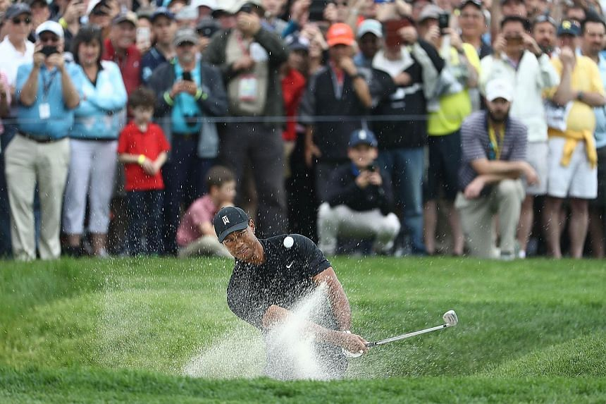 Tiger Woods playing a shot from a bunker on the first hole of the second round of the PGA Championship at Bethpage Black on Friday. The American went on to miss the cut, his ninth in 76 Major starts.