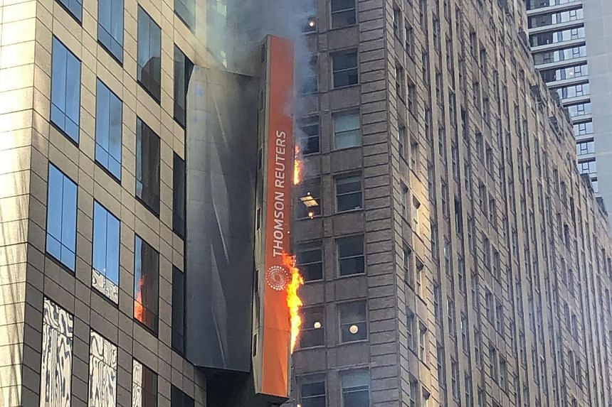 One of the large digital billboards dotting New York's iconic Times Square briefly caught fire on May 18.