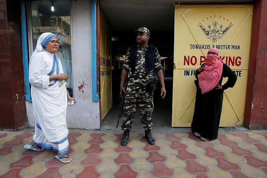 A catholic nun from the Missionaries of Charity arrives to cast her vote at a polling station during the final phase of general election in Kolkata.