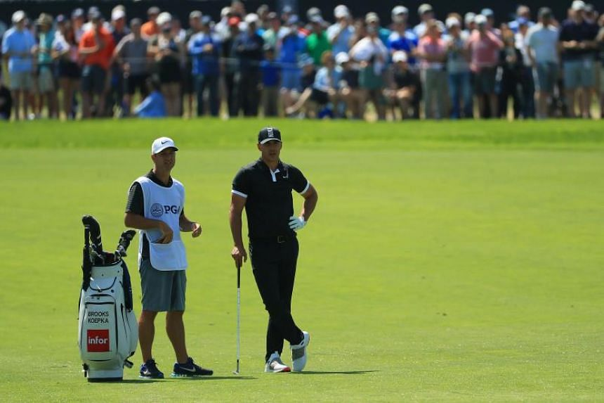 Brooks Koepka of the United States waits to play his shot on the first hole during the second round of the 2019 PGA Championship at the Bethpage Black course on May 18, 2019 in Farmingdale, New York.