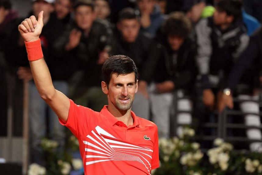 Novak Djokovic of Serbia celebrates his victory over Argentina's Diego Schwartzman at the end of their ATP Masters tournament semi-final tennis match at the Foro Italico camp in Rome, on May 18, 2019.