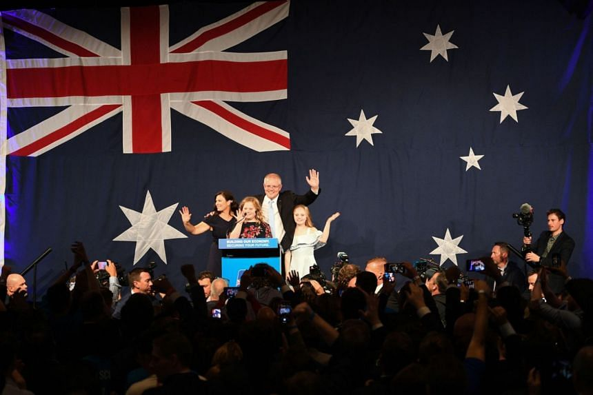 Australia's Prime Minister Scott Morrison waves to his supporters following a victory speech with his family after winning the general election, on May 18, 2019.