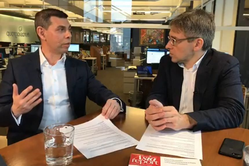 Mr Warren Fernandez (left), the editor of The Straits Times and editor-in-chief of Singapore Press Holdings' English/Malay/Tamil Media Group, seen with Time magazine's editor-at-large Ian Bremmer at a Facebook Live session on March 22 in New York