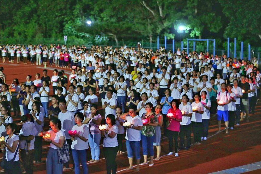 "Devotees yesterday performed various rituals, such as ""bathing the Buddha"" in remembrance of his birth, at Kong Meng San Phor Kark See Monastery in Bright Hill Road, near Bishan, and the ""three steps, one bow"" rite at Bukit Gombak Stadium (left). In"