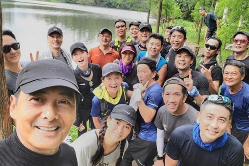 Chow Yun Fat (bottom left), whose birthday was on May 18, marked the occasion by hiking with a group of like-minded friends.