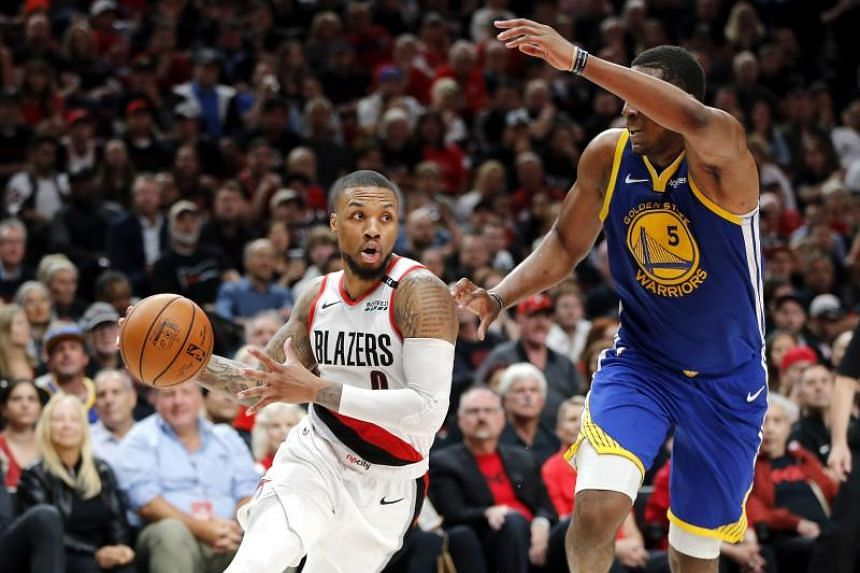 Damian Lillard of the Portland Trail Blazers dribbles the ball during the game against the Golden State Warriors, on May 18, 2019, in Portland, Oregon.