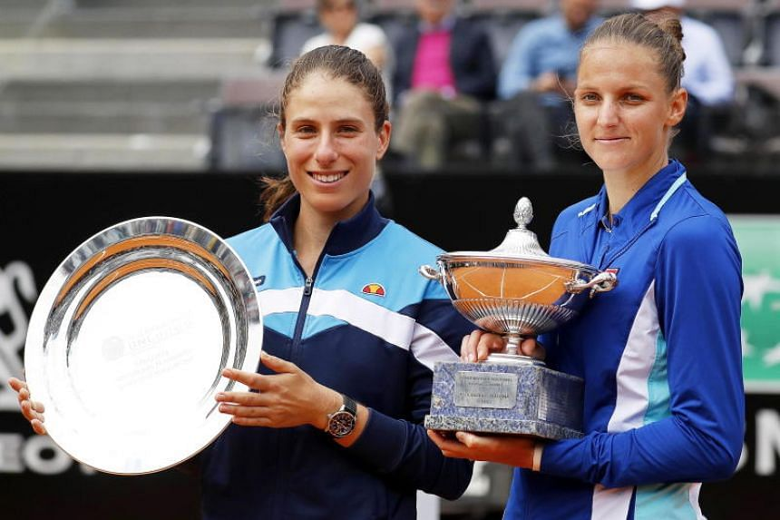 Karolina Pliskova (right) poses with her trophy after defeating Johanna Konta in their women's singles final match at the Italian Open tennis tournament in Rome, Italy, on May 19, 2019.