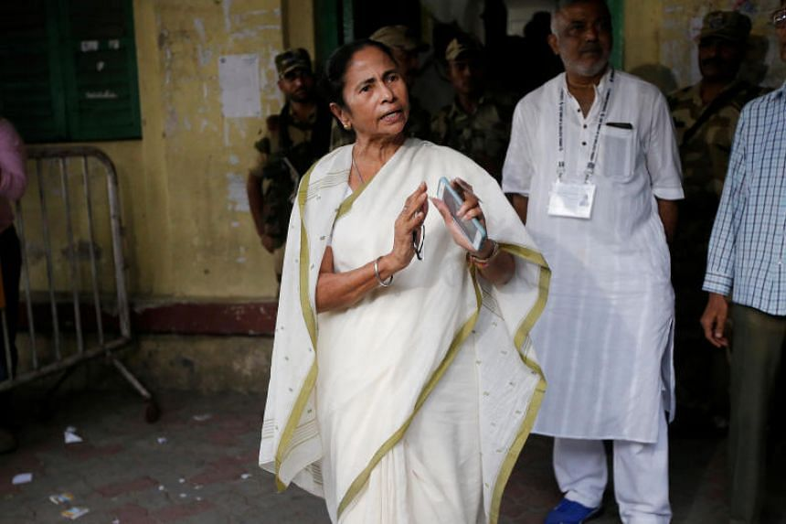 Mamata Banerjee, Chief Minister of West Bengal, talking to the media after casting her vote at a polling station in Kolkata, India, on May 19, 2019.