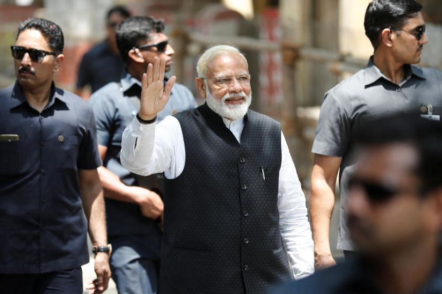 India's Modi set to win election, exit polls show